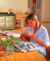 Woman reading near an Aga 6/4